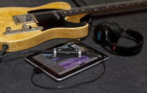 JAM connected to an iPad and a guitar.