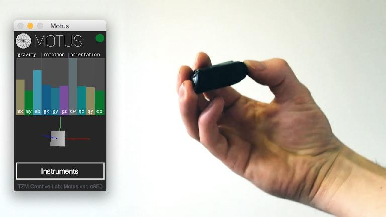 The Motus gesture controller alongside the Motus software.