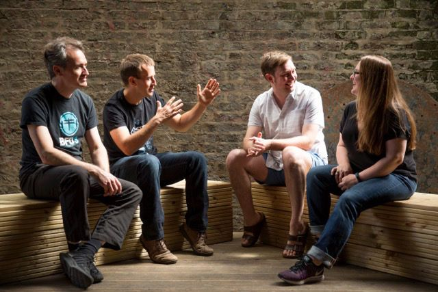 Roland Lamb, founder and CEO of ROLI (third from left), chats with Angus Hewlett, Skot McDonald, and Rhiannon Bankston-Thomas, the founders of FXpansion and new