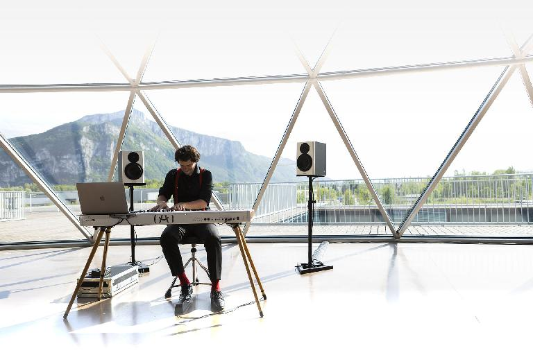 Thw wooden legs look great on the KeyLab 88 MKII, especially with a dramatic mountain background outside your studio made of glass.