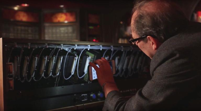 Hans Zimmer exploring the back of the Moog with his iPhone.