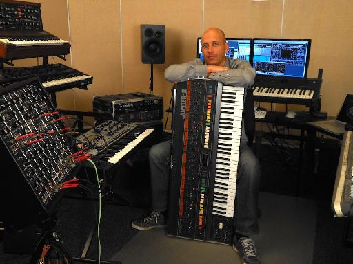 Rob Papen holds his Jupiter 8 protectively!