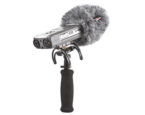 An external windshield like this model from Rycote will help to cut down any interference from the breeze.