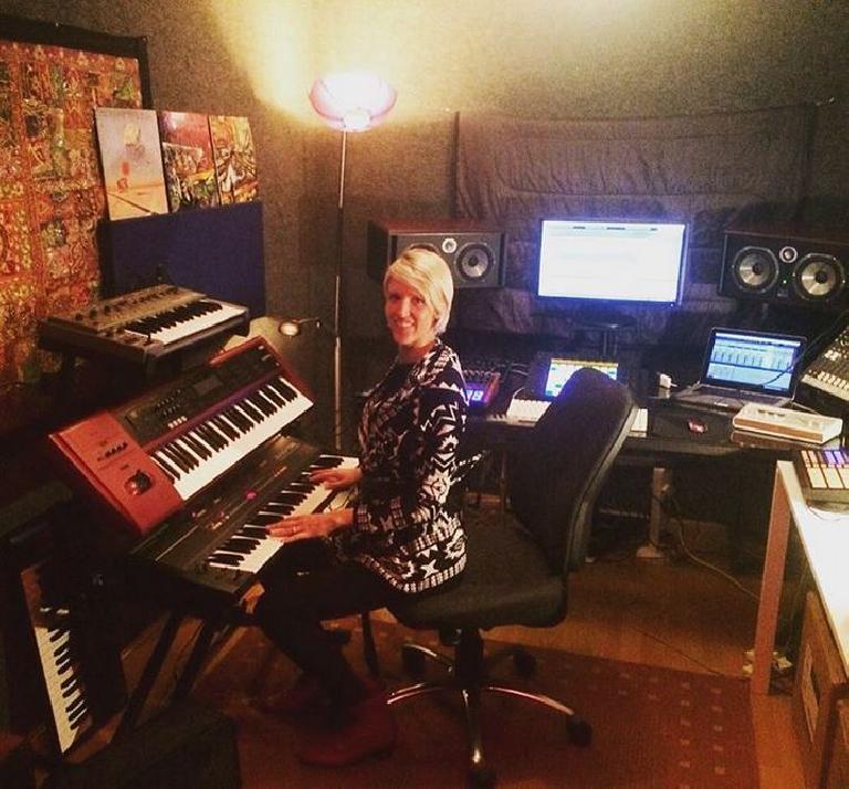 Kat Simko in the studio playing her trusty Juno-106.