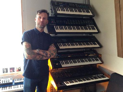 Next to the window is Liam's other stack of racked up synths.