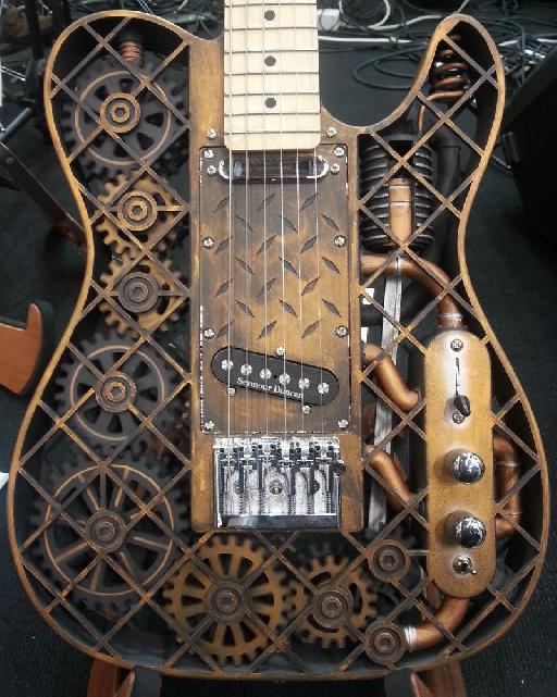 The Steampunk ODD guitar. Yes, the cogs and wheels inside rotate when being played... (see video below!)