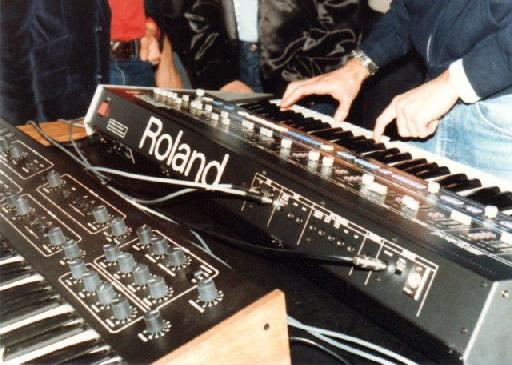 Photo from the first public demonstration of MIDI at the 1983 NAMM show. Seen here are a Roland Jupiter 6 and a Sequential Circuits Prophet 600 connected via MIDI cables. Photo courtesy of Dave Smith.