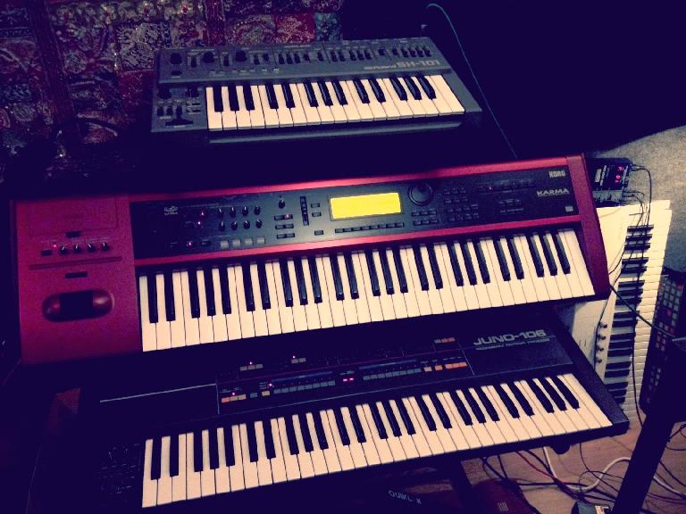 Kate's trusty Juno 106 under the Korg Karma and Roland SH-101