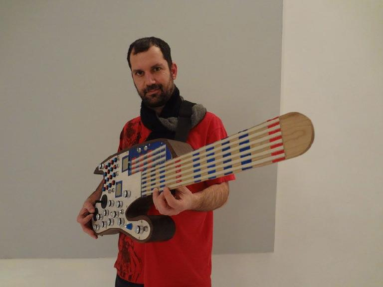 The SMOMID guitar-like MIDI instrument and its inventor Nick Demopoulos.