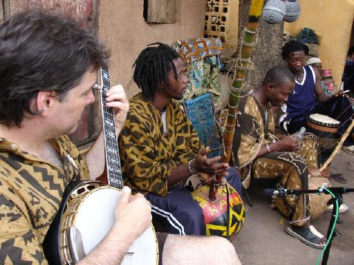 Bela Fleck playing with African musicians in Africa. From the DVD 'Throw Down Your Heart'