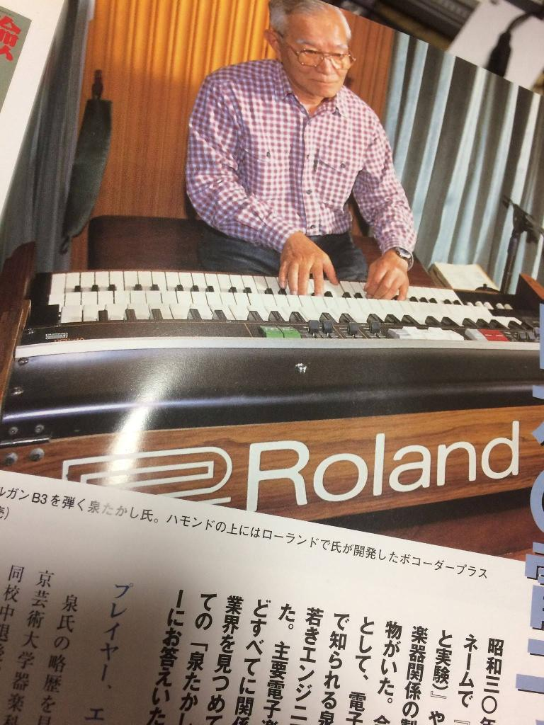 Noriyasu San playing a Roland synthesizer.