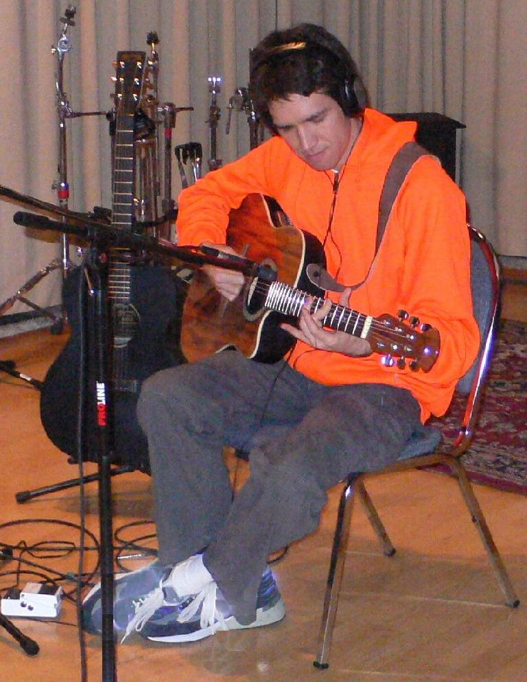 Fig 1 An acoustic guitar in a typical recording space