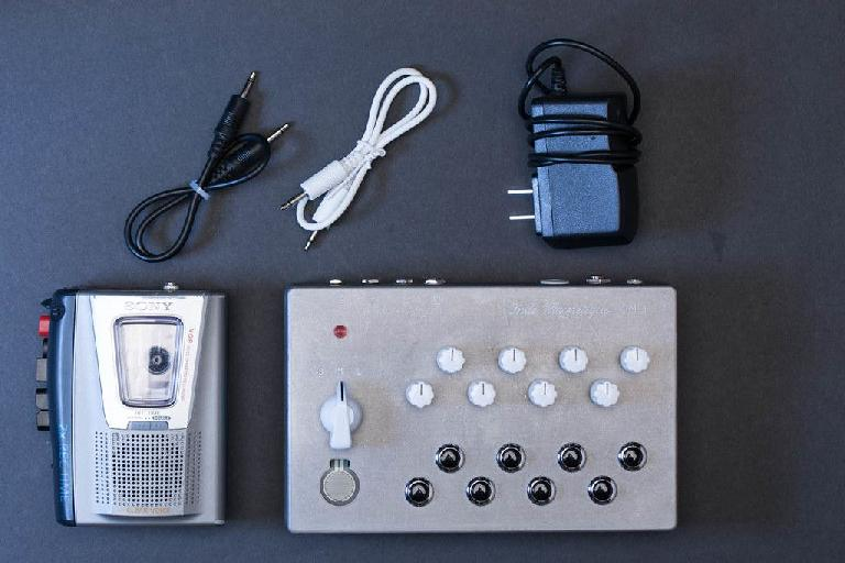 The OM-1 cassette synthesizer contents include a modified cassette player/recorder.