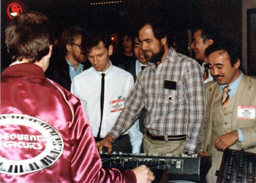 In this never-before published photo, Dave Smith demonstrates MIDI at NAMM, 1983. Looking on are Yukio Tamada of Roland (right) and Jim Mothersbaugh (left). (Photo courtesy Dave Smith.)