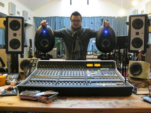 Rik with his prized SE Egg monitors and SSL Matrix in the Coldplay studio. (Rasberries infront of desk not included.)