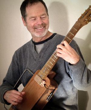 Bart Hopkins and his Floating Guitar instrument. Photo credit: childsplaymusic.com.au