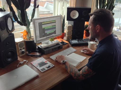 Liam Howe working away at his studio desk in The Laundry, London.