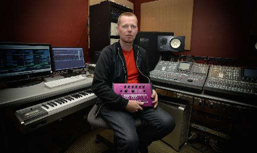 Nic with some favorite gear. Can you guess what the pink box is?
