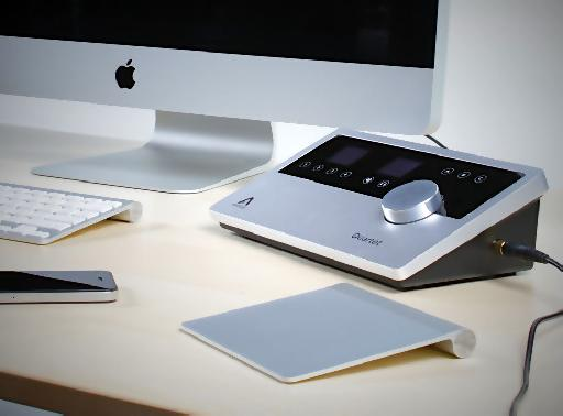 The Quartet next to an iMac, iPhone and Apple's Magic Trackpad.